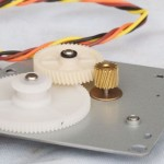 Anti-Skip Gear & Stepper Motor Under Plate